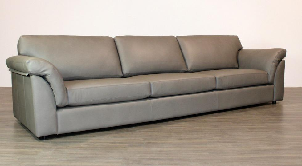 x-long leather sofa with arm cushions
