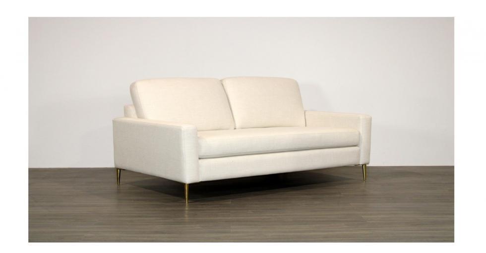 white fabric condo sofa