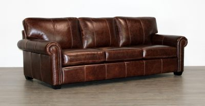 brown leather sofa with back cushions with seams