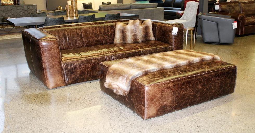 brown distressed leather sofa and ottoman