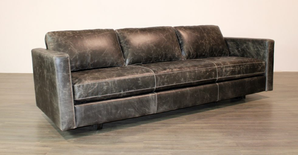 leather sofa with a wood spine