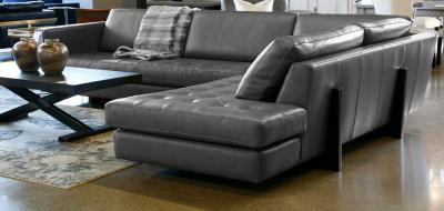 leather sectional with wood base and tufted seats