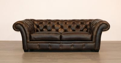 tufted sofa with flared arms